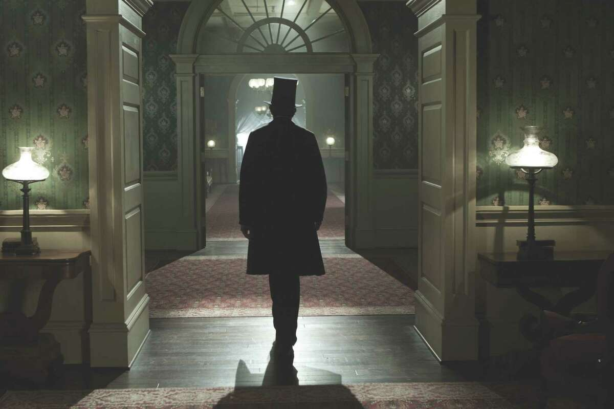 """David James/DreamWorks II Distribution Co. Abraham Lincoln (Daniel Day-Lewis) walks through the corridors of the White House in this scene from director Steven Spielberg's drama """"Lincoln"""" from DreamWorks Pictures and Twentieth Century Fox."""