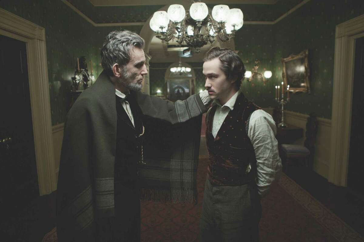 """David James/DreamWorks II Distribution Co., LLC President Lincoln (Daniel Day-Lewis) speaks with his eldest son, Robert Todd Lincoln (Joseph Gordon-Levitt) in this scene from director Steven Spielberg's drama """"Lincoln"""" from DreamWorks Pictures and Twentieth Century Fox."""