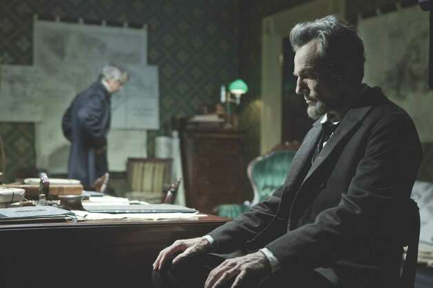 "David James/DreamWorks II Distribution Co., LLC  President Lincoln (Daniel Day-Lewis, right) confers with his Secretary of State, William Seward (David Strathairn) in this scene from director Steven Spielberg's drama ""Lincoln"" from DreamWorks Pictures and Twentieth Century Fox."