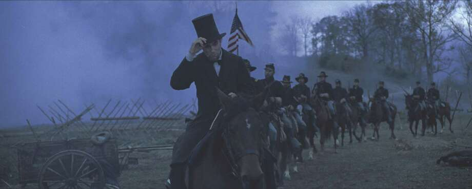 "President Abraham Lincoln (Daniel Day-Lewis) looks across a battlefield in the aftermath of a terrible siege in this scene from director Steven Spielberg's drama ""Lincoln"" from DreamWorks Pictures and Twentieth Century Fox...© 2012 DreamWorks II Distribution Co., LLC and Twentieth Century Fox Film Corporation. ÊAll Rights Reserved."