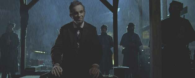 "Daniel Day-Lewis stars as President Abraham Lincoln in this scene from director Steven Spielberg's drama ""Lincoln"" from DreamWorks Pictures and Twentieth Century Fox...© 2012 DreamWorks II Distribution Co., LLC and Twentieth Century Fox Film Corporation.  All Rights Reserved."