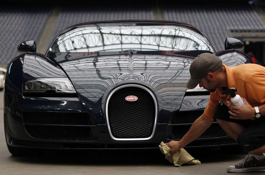 The Bugatti Veyron 16.4 Super Sport is considered the fastest production car in the world. Click ahead for other Bugatti cars that may not be quite as fast but still among the fastest in the world. (Johnny Hanson / Houston Chronicle)