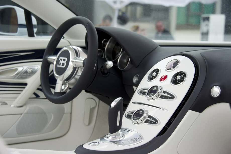 "Inside view of a newly-unveiled Bugatti Veyron 16,4 Grand Sport ""L'Or Blanc"" in Berlin June 30, 2011. The luxury sports car, designed in cooperation with KPM - Königliche Porzellan-Manufaktur Berlin (Royal Porcelain Manufacture Berlin) features designs inspired from porcelain, and porcelain elements, costs EUR 1.600.000. ( JOHN MACDOUGALL / AFP/Getty Images)"