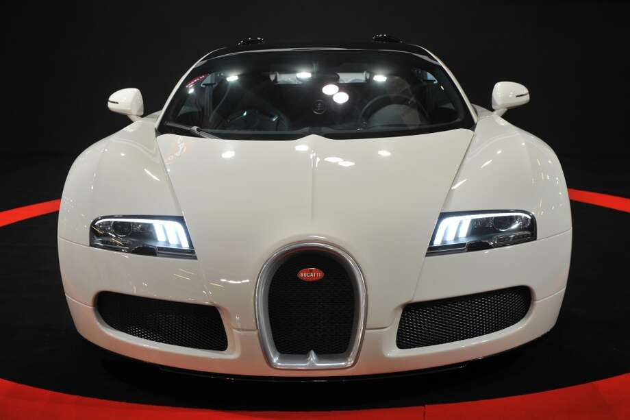 A Bugatti Veyron 16.4 Grand Sport, the fastest convertible car in the world, is seen at the Top Marques Macau car show in Macau on November 25, 2011.  The Top Marques Macau car show, which is orginally from Monaco, showcases a star studded line-up of supercars to a Mainland Chinese client base and is the only car show with a live test track where invited clients are allowed to test drive cars.   The Bugatti Veyron 16.4 Grand Sport, which has a top speed of 407 km/h, is worth 2.12 million USD and only 150 units were made.  (AARON TAM / AFP/Getty Images)