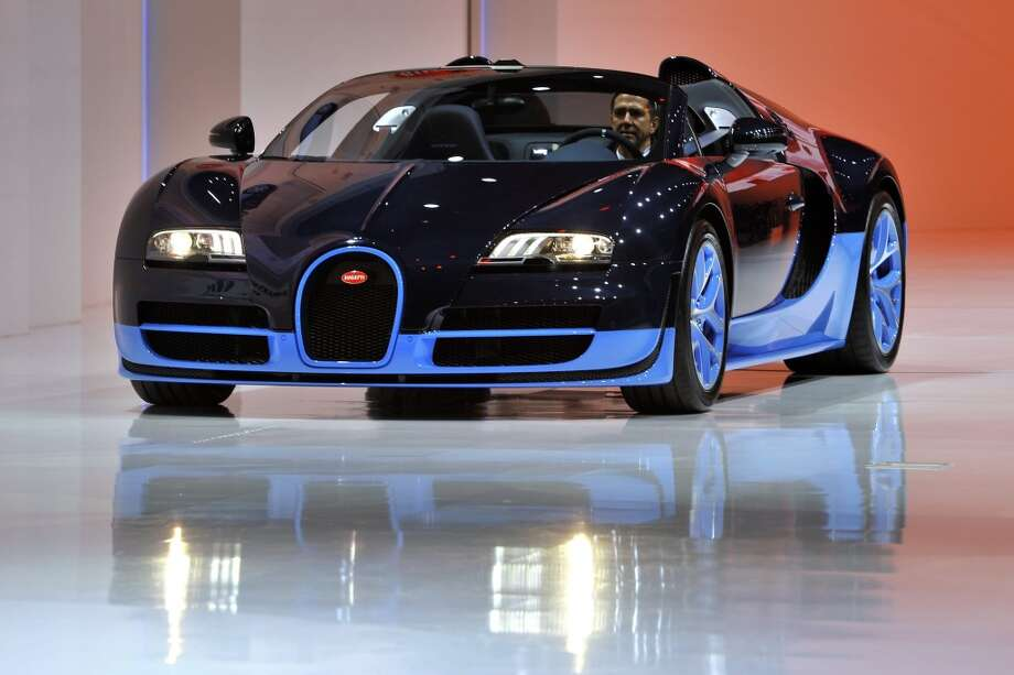 The new Bugatti Veyron Grand Sport Vitesse is seen during a preview of Volkwagen Group on March 5, 2012 ahead of the 82nd Geneva Car Show in Geneva. Some 700 carmakers hold a press preview of their newest batch of automobiles at the Geneva Motor Show. (FABRICE COFFRINI / AFP/Getty Images)