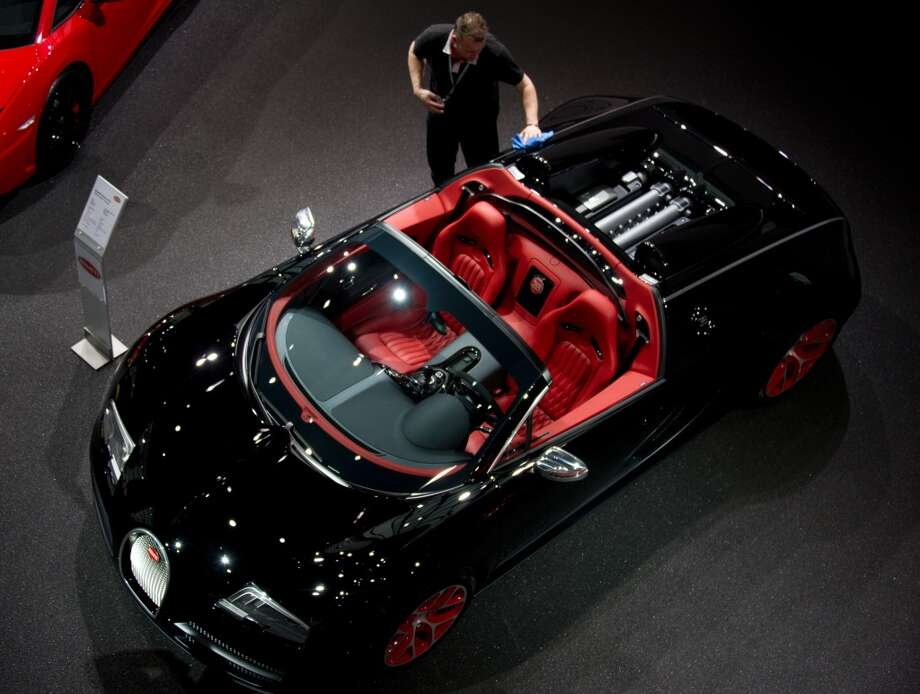 A man polishes a Bugatti Veyron car prior to a press conference of German automaker Volkswagen (VW) on March 12, 2012 in Wolfsburg, central Germany. (JOCHEN LUEBKE / AFP/Getty Images)