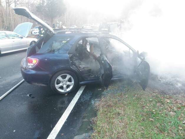 Smoking shell of a car that caught fire after a multi-vehicle crash Wednesday on the Merritt Parkway, which drivers said took place after they hit a coyote on the highway.  Westport CT 11/14/12 Photo: Westport Fire Department / Westport News contributed