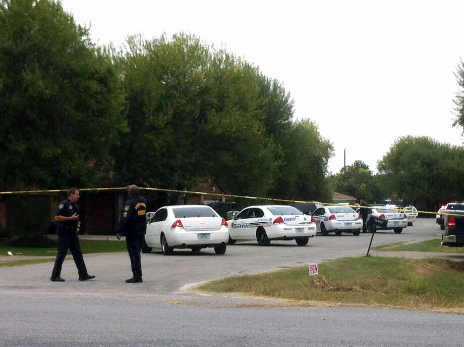 Officials investigate at the shooting scene Wednesday in Channelview. Photo: Cody Duty, Houston Chronicle