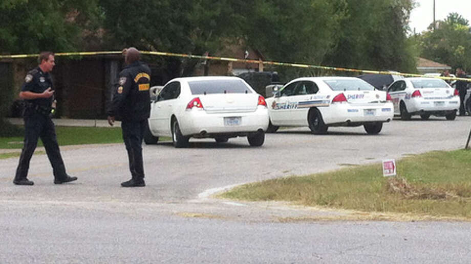 Officials investigate a scene after a man was killed and another wounded in Channelview on Wednesday. Photo: .