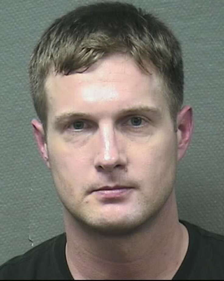 John Daniel Hayman, a Galveston middle school assistant principal, is on administrative leave after his arrest on drug charges. Photo: HPD