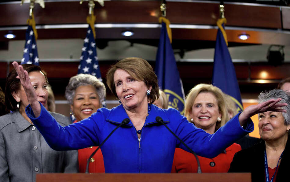House Minority Leader Nancy Pelosi of Calif., accompanied by women House Democrats, gestures during