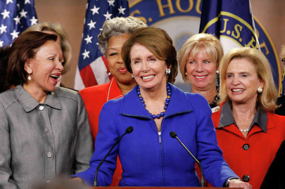 House Minority Leader Nancy Pelosi, a Democrat from California, center, speaks during a news conference at the U.S. Capitol in Washington, D.C., U.S., on Wednesday, Nov. 14, 2012. Pelosi, the first female speaker when Democrats controlled the chamber from 2007 to 2011, said she will stay for another two-year term as leader of the caucus. Photo: Rich Clement, Bloomberg / © 2012 Bloomberg Finance LP