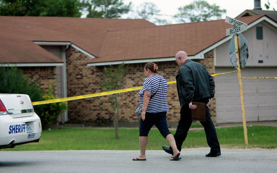 A woman is taken to a patrol car at a scene after a a man was fatally shot and another wounded Wednesday, Nov. 14, 2012, in Channelview. Photo: Cody Duty, Houston Chronicle / © 2012 Houston Chronicle