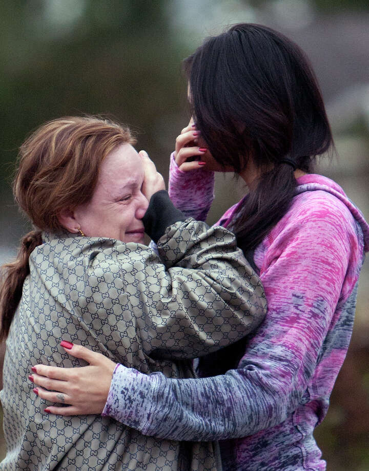 Friends and family cry at a scene after a a man was fatally shot and another wounded Wednesday, Nov. 14, 2012, in Channelview. Photo: Cody Duty, Houston Chronicle / © 2012 Houston Chronicle