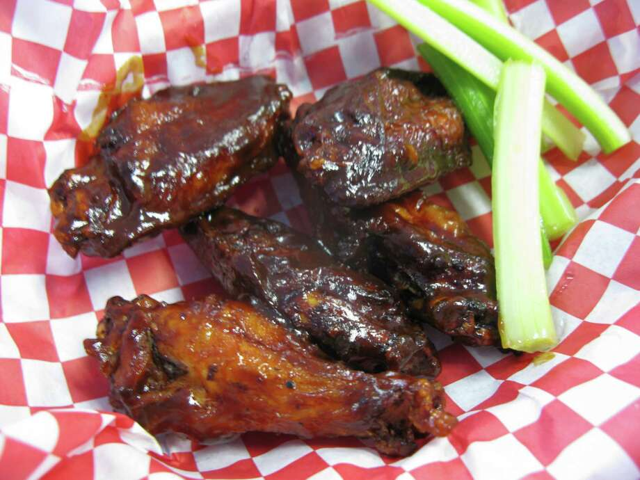 My Dad's Wings are served with a tangy and spicy barbecue sauce.