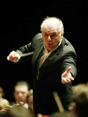 "** FILE ** Maestro Daniel Barenboim conducts the West-Eastern-Divan Orchestra during a rehearsal for a concert which is part of the Salzburg Festival, in this Aug. 13, 2007 file photo. An opera by Richard Wagner - whose music and anti-Semitic writings influenced Adolf Hitler - will be performed at an open-air theater built under the Nazi regime by an orchestra made up of Israeli and Arab musicians and conducted by a Jew. Star conductor Daniel Barenboim told Germany's Die Zeit newspaper that the West-Eastern Divan Orchestra, which he co-founded, plans next year to perform the first act of Wagner's ""Die Walkuere"" at Berlin's Waldbuehne - an arena built as part of the complex for the 1936 Olympics by the Nazis. (AP Photo/Kerstin Joensson) Photo: Kerstin Joensson / AP"