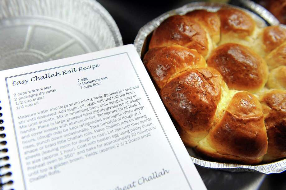 "Baked Challah bread rolls and the recipe from ""A Taste of Shabbos House"" cookbook on Thursday, Oct. 4, 2012, at Shabbos House Rohr Chabad Jewish in Albany, N.Y. (Cindy Schultz / Times Union) Photo: Cindy Schultz /  00019531A"