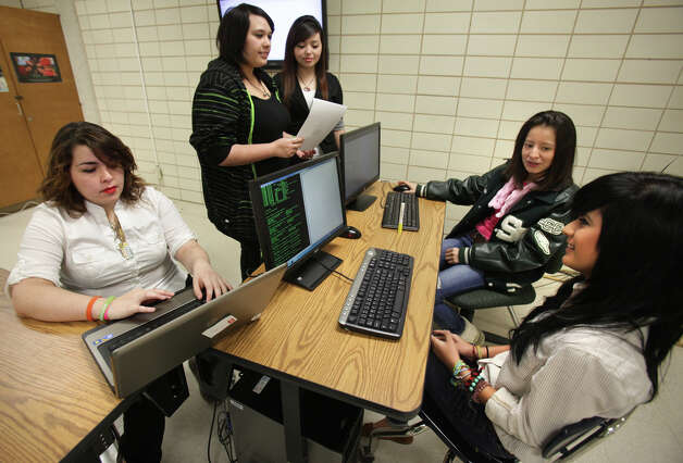 Members of the Southwest High School Lady Cyber Dragons, Vanessa Howard, left to right, Sabrina Goetsch, Maria Chavez, Narda Mendez and Deidre Carrillo, practice for the upcoming Cyber Patriot, a national high school cyber security competition, which starts this Friday.  Wednesday, Nov. 14, 2012. Photo: Bob Owen, San Antonio Express-News / © 2012 San Antonio Express-News