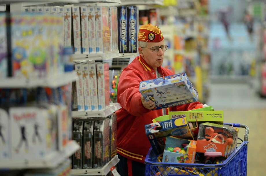 "Marine Corps League member Tim Forbes searches for more toys at the Toys R Us store in Colonie, N.Y. for the ""Toys for Tots"" program Nov. 14, 2012.  (Skip Dickstein/Times Union) Photo: Skip Dickstein / 00020134A"