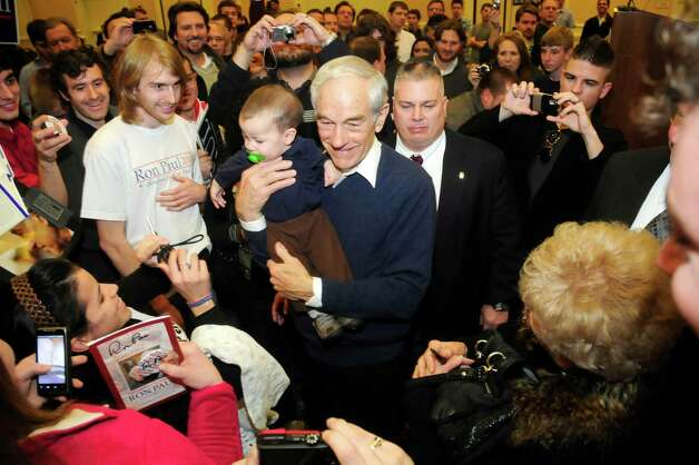 Ron Paul took time to hold 7-month-old Brody Grant of Gainesville, Ga. at the Spartanburg Marriott at Renaissance Park on Tuesday, Jan. 17, 2012, in Spartanburg, S.C. Photo: ALEX C. HICKS JR, Associated Press / SPARTANBURG HERALD JOURNAL
