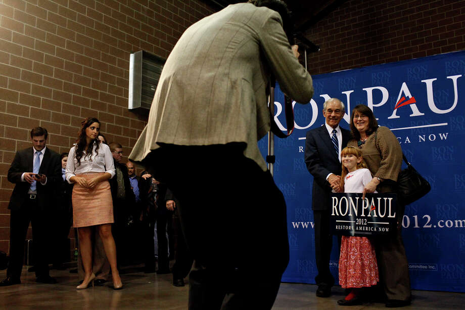 Texas Congressman Ron Paul poses with supporters after his Salute to Veterans rally at the Iowa State Fairgrounds in Des Moines, Iowa on Wednesday, Dec. 28, 2011. Photo: LISA KRANTZ, SAN ANTONIO EXPRESS-NEWS / SAN ANTONIO EXPRESS-NEWS