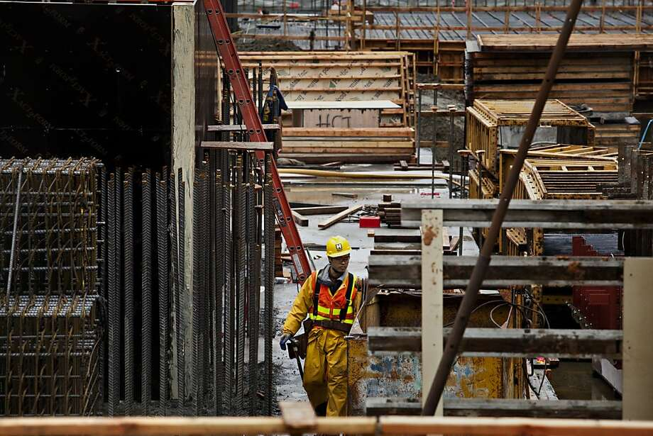 The construction industry in San Francisco stands to benefit from the stream of employees in the technology sector coming to work and live in the city. Photo: Jason Henry, Special To The Chronicle