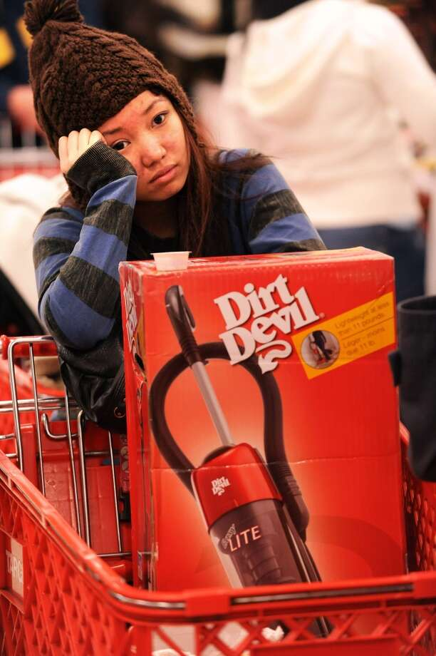 "Black Friday shopper Susan Tu lines up to buy an iPod touch shortly after Target's 5 a.m. opening on Friday, Nov. 27, 2009, in Daly City, Calif. Customers began lining up around 10 p.m. Thanksgiving night for deals that included 40"" LCD televisions for $449 and 50% off certain items. (Noah Berger / Special to The Chronicle)"