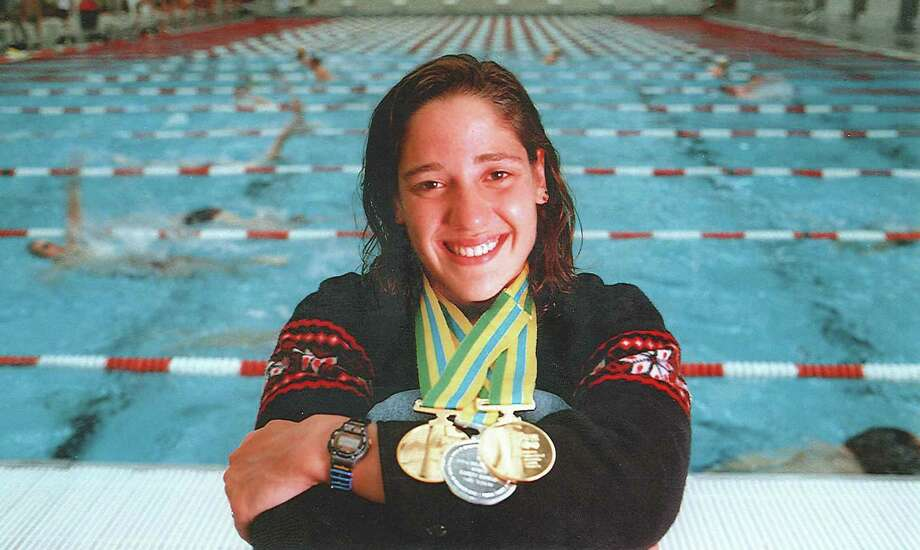 "The YWCA Greenwich Dolphins will host ""Training for Success,"" a series of seminars featuring  All-American and Olympic swimming medalists, along with Stamford Health professionals, addressing how to succeed in swimming and beyond. The first seminar will be held on Sunday, Nov. 18 at 2 p.m. and features a pair of the country's most accomplished swimmers, Kristy Kowal and Brooke Bennett. Pictured here is Kowal, an Olympic Silver medalist in the 2000 Olympics in Sydney, and a three-time World Championship gold medalist. She has held eight American Records, along with one world record. Photo: Contributed Photo / Greenwich Citizen"