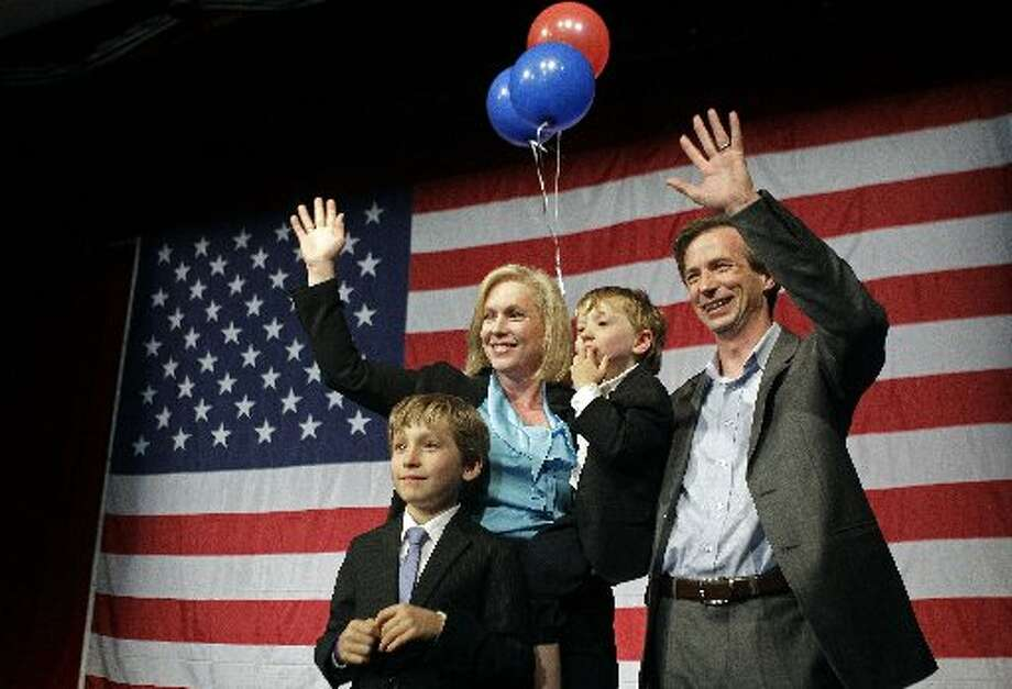 U.S. Sen. Kirsten Gillibrand D-N.Y. and her husband and two sons celebrate on stage at New York State Democratic Headquarters on election night. (AP Photo/Kathy Willens)