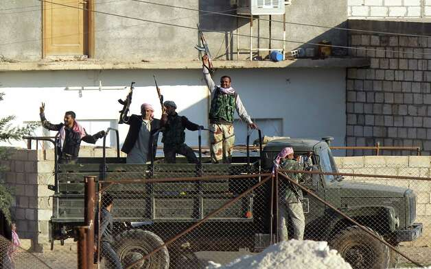 Syrian opposition fighters celebrate on the strategic Syrian border town of Ras al-Ain. Syria's internal conflict threatens to spread across the region, creating a nightmare scenario. Photo: Bulent Kilic, AFP / Getty Images / AFP