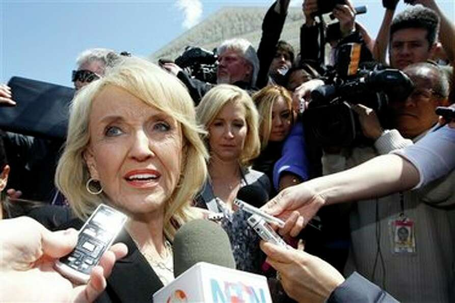 Arizona Gov. Jan Brewer speaks to reporters outside the Supreme Court in Washington, Wednesday, Apri