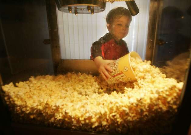 You don't need a popcorn machine to provide a theater experience in your home. Photo: Kat Wade, SFC