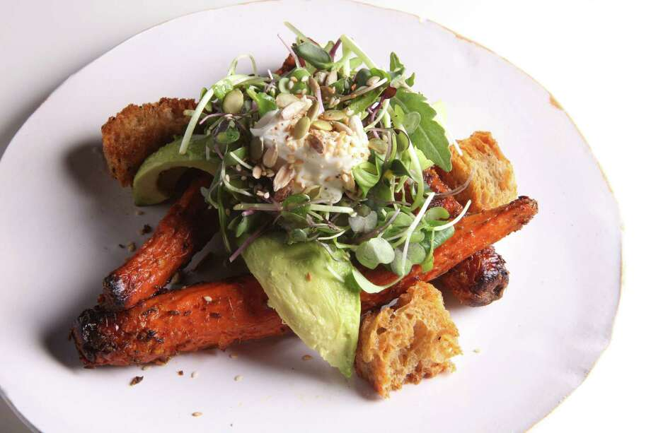 A dish of roasted carrot and avocado salad, in New York, Oct. 23, 2012. Carrots have suddenly become an engine driving restaurant menus as chefs showcase handsome, meaty specimens dressed and garnished without a sliver of meat or fish. (Andrew Burton/The New York Times) Photo: ANDREW BURTON / NYTNS