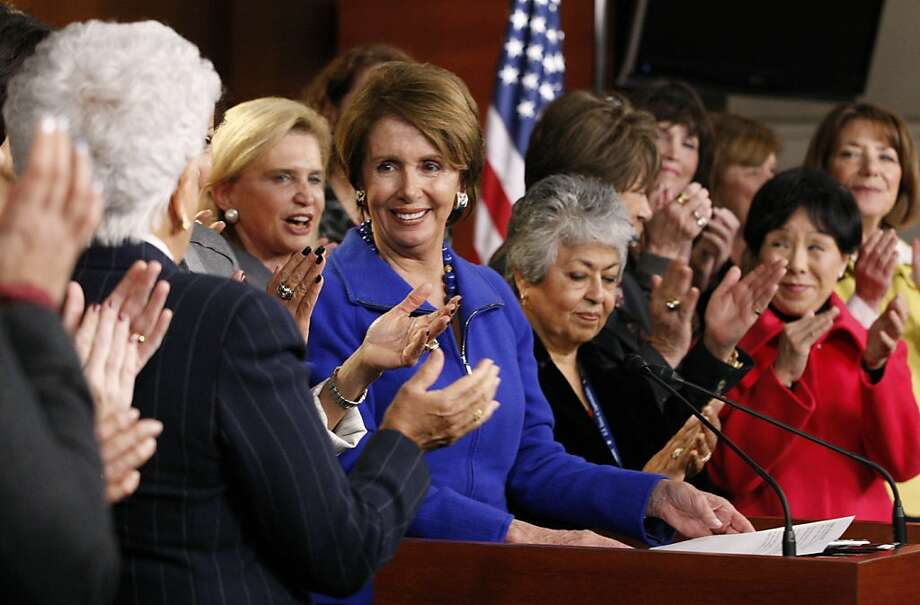 U.S. House Minority Leader Nancy Pelosi, a Democrat from California, center left, is applauded by female House Democrats during a news conference at the U.S. Capitol in Washington, D.C., U.S., on Wednesday, Nov. 14, 2012. Pelosi, the first female speaker when Democrats controlled the chamber from 2007 to 2011, said she will stay for another two-year term as leader of the caucus. Photographer: Rich Clement/Bloomberg *** Local Caption *** Nancy Pelosi Photo: Rich Clement, Bloomberg