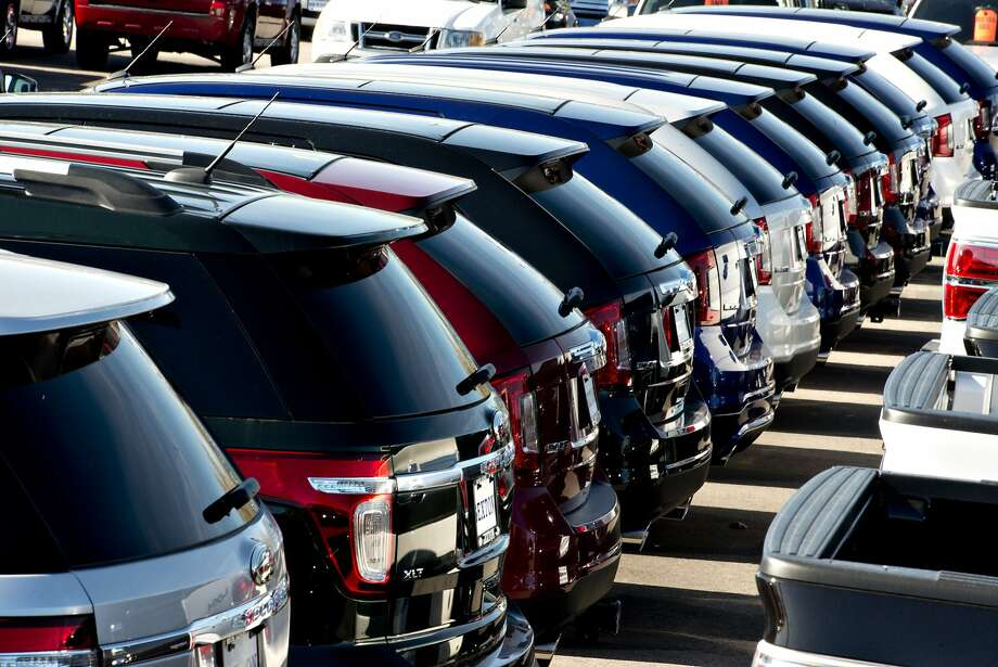 A row of 2013 Ford Motor Co. Explorer and Edge vehicles sit on the lot at Sexton Ford auto dealership in Moline, Illinois, U.S., on Friday, Oct. 26, 2012. The U.S. Census Bureau will release figures on domestic auto sales on Nov. 1. Photographer: Daniel Acker/Bloomberg Photo: Daniel Acker, Bloomberg