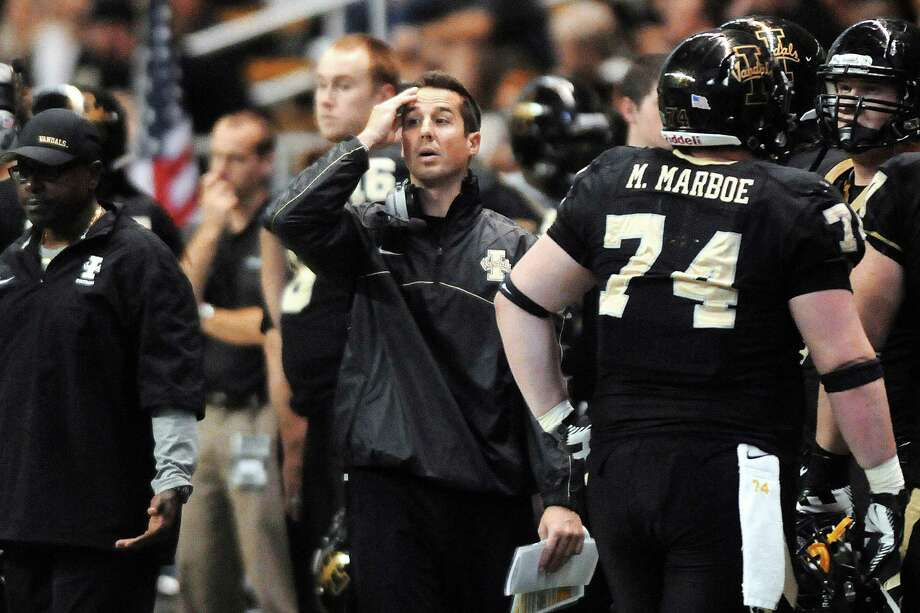 Former Idaho coach Jason Gesser reacts after a pass from quarterback Logan Bushnell is intercepted and returned for a touchdown by San Jose State during the fourth quarter of their NCAA college football game, Saturday, Nov. 3, 2012, in Moscow, Idaho. San Jose State won 42-13. (AP Photo/Lewiston Tribune, Kyle Mills) Photo: Kyle Mills, Associated Press / Lewiston Tribune