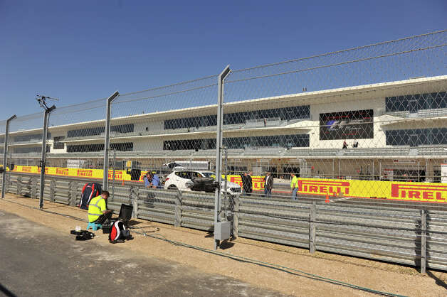 Workers put the finishing touches on the Circuit of the Americas near Austin Wednesday. The circuit, financed in part by San Antonio businessman Red McCombs, will host the Formula 1 United States Grand Prix Sunday. Photo: Robin Jerstad/For The Express-Ne