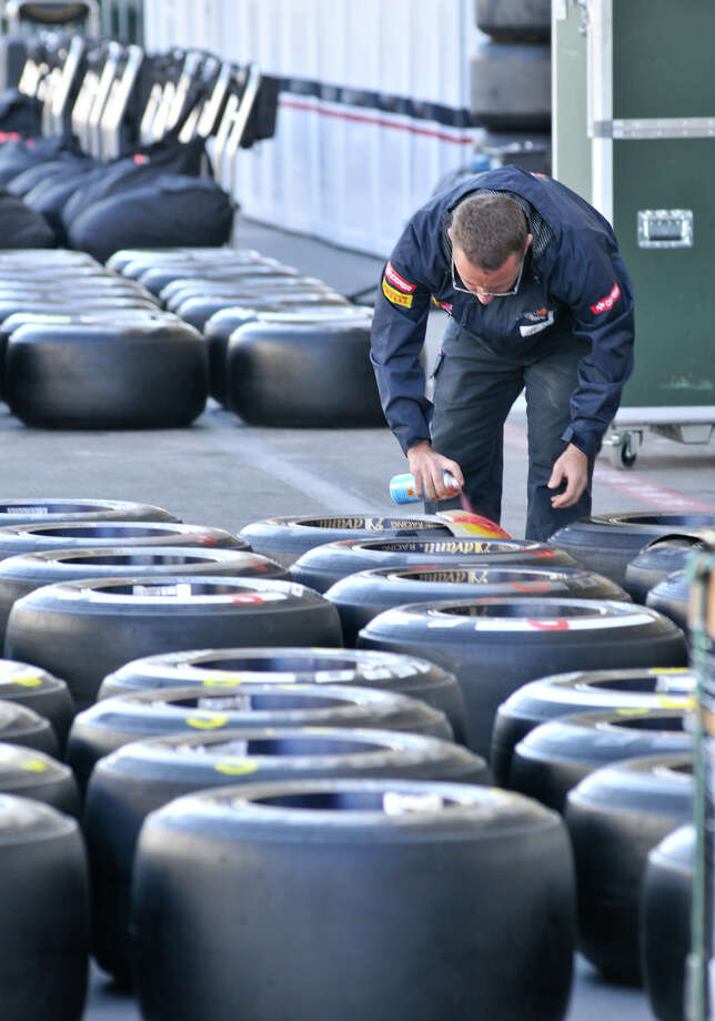 A crewman does preperation work as Formula 1 race teams set up Wednesday at Austin's Circuit of the America's for Sunday's United States Grand Prix. San Antonio businessman Red McCombs the major investor in the track. Photo: Robin Jerstad/For The Express-Ne