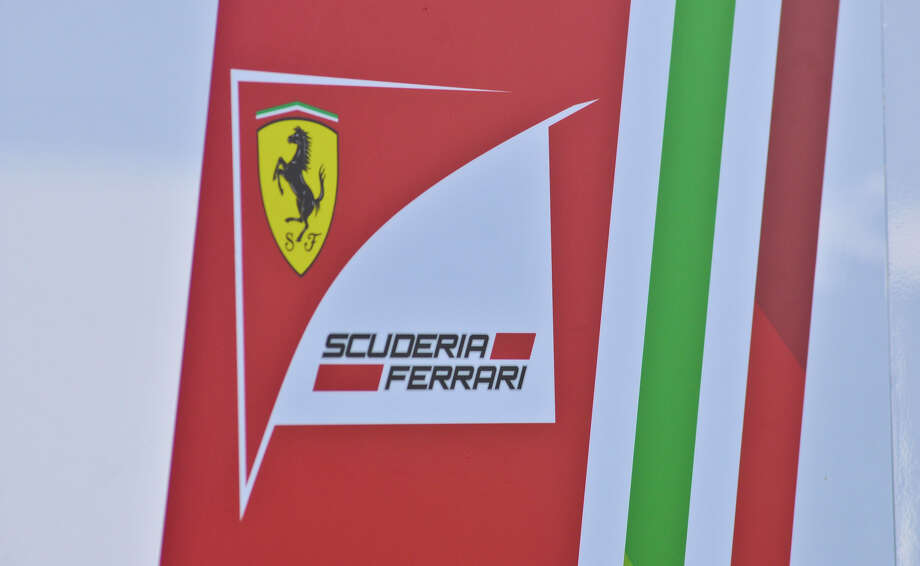 The logo of the Ferrari team adornes their garage as preparations continue for Sunday's United States Grand Prix at Austin's Circuit of the America's. San Antonio businessman Red McCombs is the major investor in the project. Photo: Robin Jerstad/For The Express-Ne