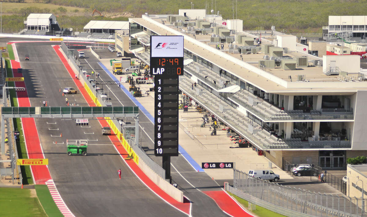 Workers put the finishing touches on the Circuit of the Americas near Austin Wednesday. The circuit, financed in part by San Antonio businessman Red McCombs, will host the Formula 1 United States Grand Prix Sunday.