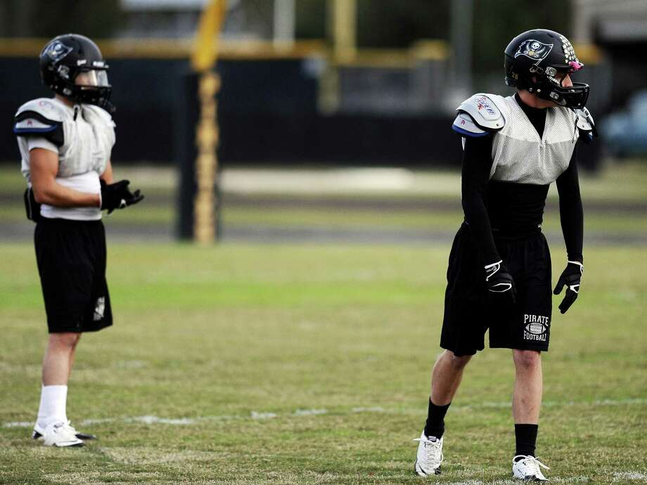 Vidor cornerbacks Austin Rodrguez, left, and Quentin Whitmire, right, practice defensive drills at practice on Tuesday, November 13, 2012. The Vidor football team will play Humble Summer Creek at 7 p.m. Friday at Clyde Abshier Stadium in Deer Park.  Photo taken: Randy Edwards/The Enterprise