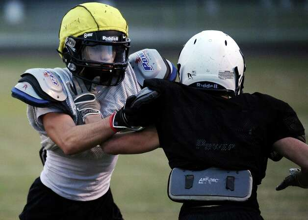 Vidor cornerback Austin Rodrguez, left, runs defensive drills at practice on Tuesday, November 13, 2012. The Vidor football team will play Humble Summer Creek at 7 p.m. Friday at Clyde Abshier Stadium in Deer Park.  Photo taken: Randy Edwards/The Enterprise Photo: Randy Edwards