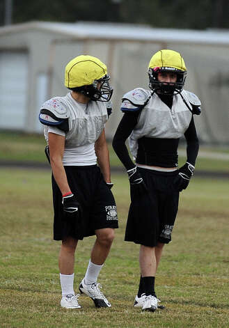 Vidor cornerbacks Austin Rodrguez, left, and Quentin Whitmire, right, practice defensive drills at practice on Tuesday, November 13, 2012. The Vidor football team will play Humble Summer Creek at 7 p.m. Friday at Clyde Abshier Stadium in Deer Park.  Photo taken: Randy Edwards/The Enterprise Photo: Randy Edwards