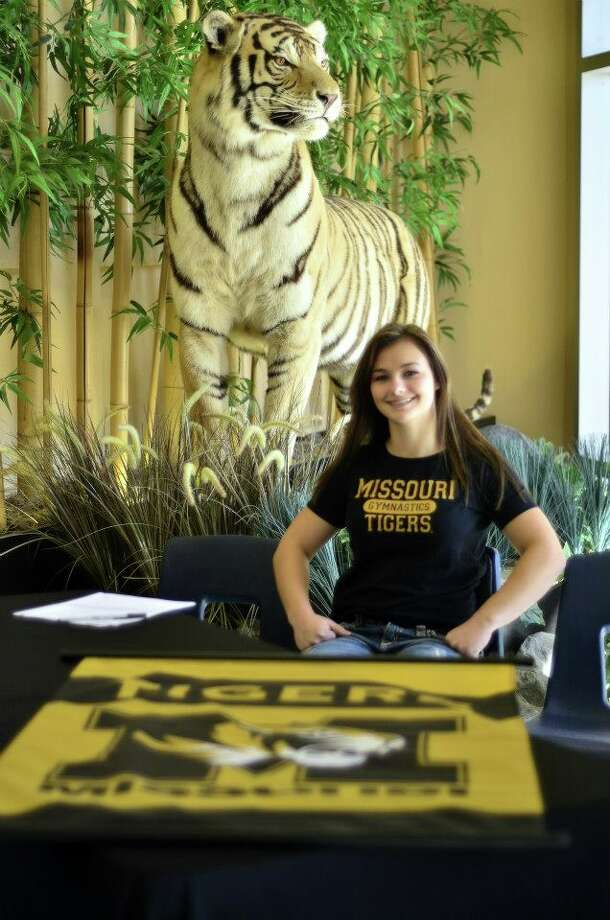 Alyson Heimsath of Conroe HS signs to University of Missouri Gymnastic Team (Courtesy of Conroe Athletic Department)