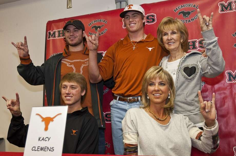 Kacy Clemens, top center, takes a picture with his family during a ceremony for his intent to attend Texas on a baseball scholarship, Wednesday, Nov. 14, 2012, in Memorial High School in Houston. His brother Kody Clemens, top left, grandmother Jan Wilde, top right, brother Koby Clemens, bottom left, and mother Debbie Clemens. (Nick de la Torre / Chronicle)