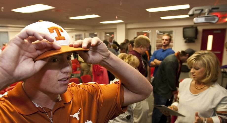 Kacy Clemens, talks about developing throwing velocity and the positives to having his fathers name during a ceremony for his intent to attend Texas on a baseball scholarship, Wednesday, Nov. 14, 2012, in Memorial High School in Houston. (Nick de la Torre / Chronicle)