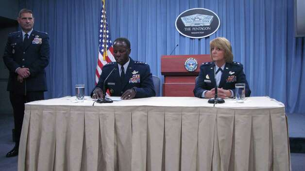 Gen. Edward Rice Jr. and Maj. Gen. Margaret Woodward met with the media at a press conference on Thursday 14, 2012, in the Pentagon as Col. Steve Clutter stands nearby to field questions. The commanders met with reporters to outline the results of an investigaton into sexual misconduct among basic training instructors at Joint Base San Antonio-Lackland. Photo: Sig Christenson, San Antonio Express-News / San Antonio Express-News
