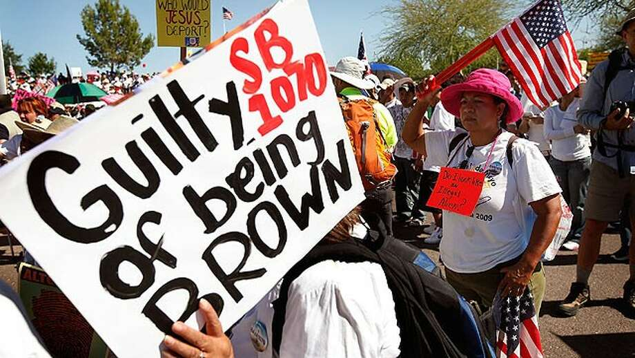 Demonstrators prepare to march in May of 2010 to protest the Arizona Immigration Law. (Scott Olson/Getty Images)