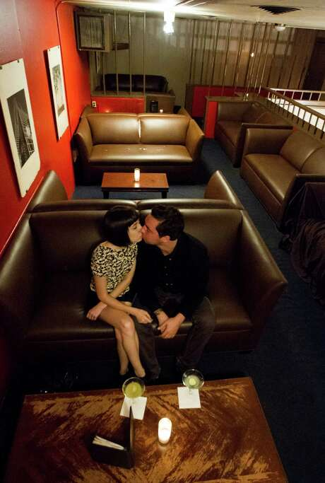 The upstairs lounge of Marfreless has a reputation for being a place where couples, such as Justice Tirapelli-Jamail and his girlfriend, Gabriella Hulet, can get to know one another better. Photo: J. Patric Schneider, Freelance / © 2012 Houston Chronicle