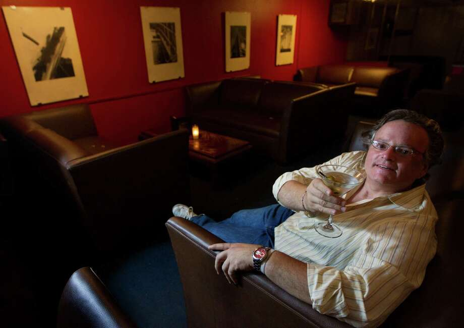Bar owner Michael Wells in the upstairs lounge of the Marfreless bar in River Oaks on Wednesday, Nov. 7, 2012, in Houston.( J. Patric Schneider / For the Chronicle ) Photo: J. Patric Schneider, Freelance / © 2012 Houston Chronicle